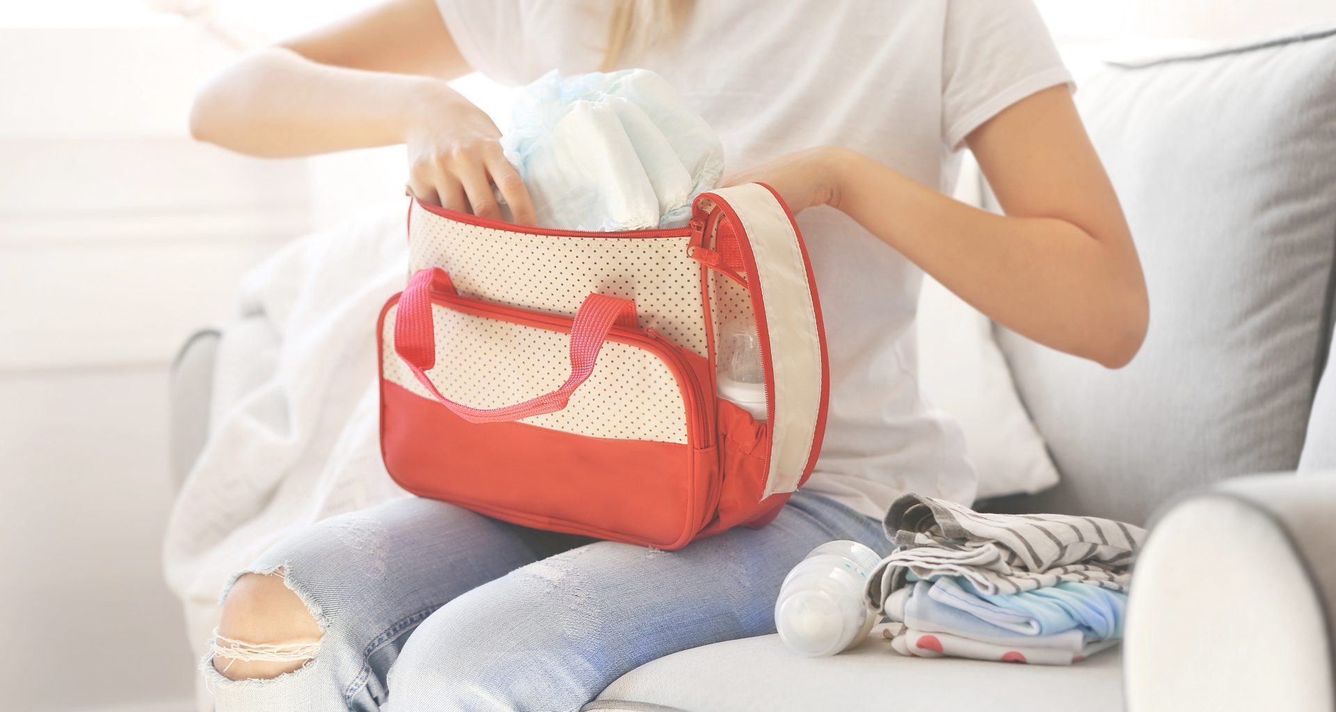 woman packing a diaper bag