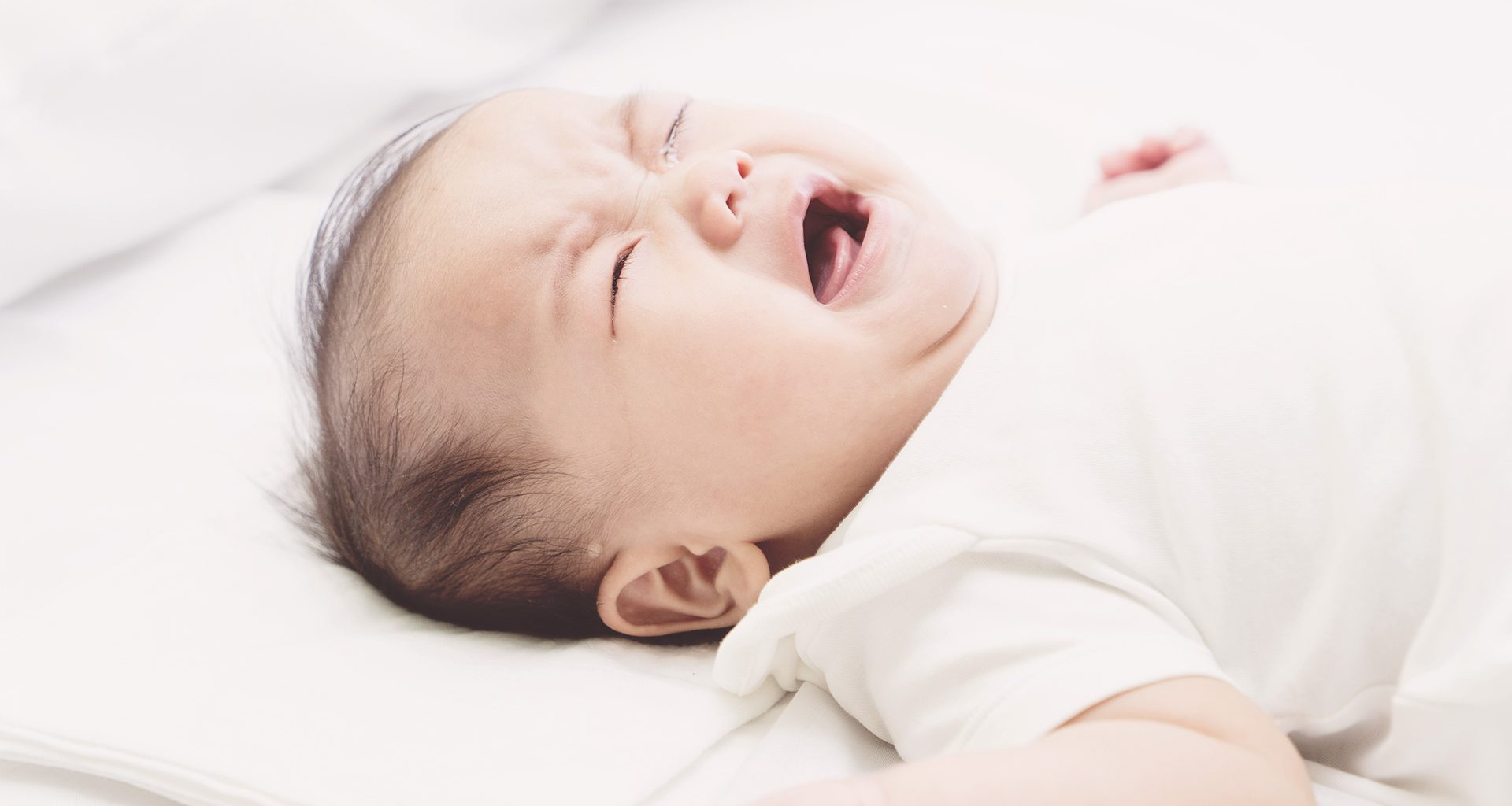 why does my baby wake up crying?