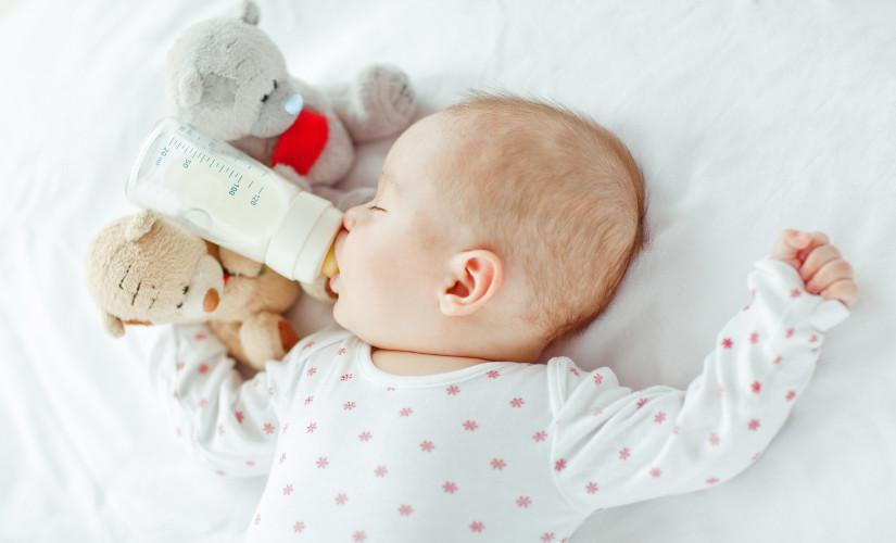 Baby sleeping with bottle
