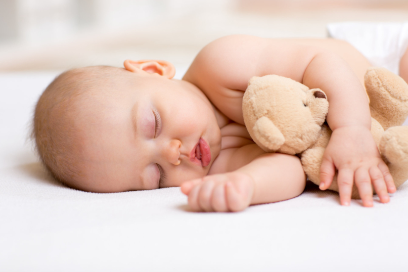 when do babies sleep through the night