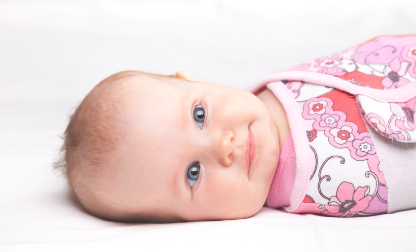 How and when to stop swaddling