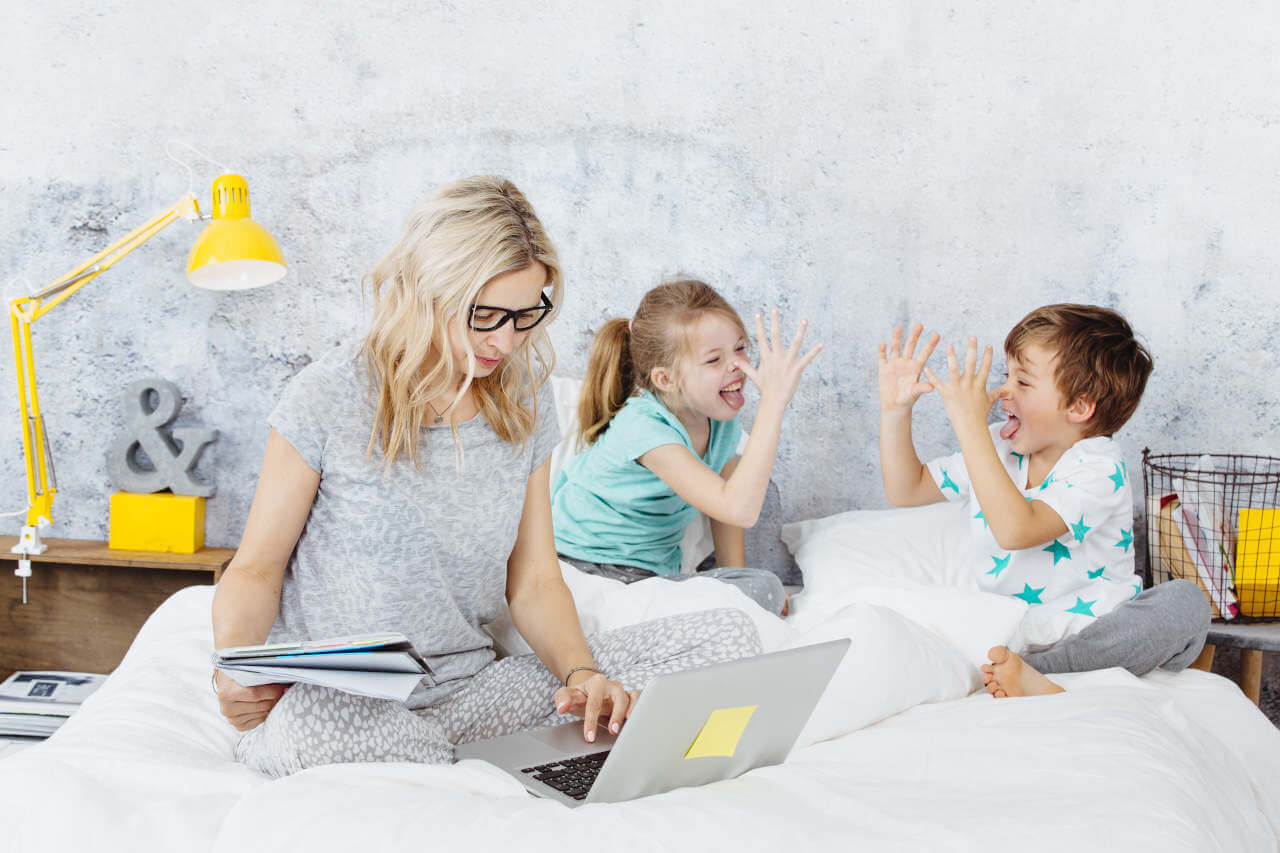 woman working from home with kids